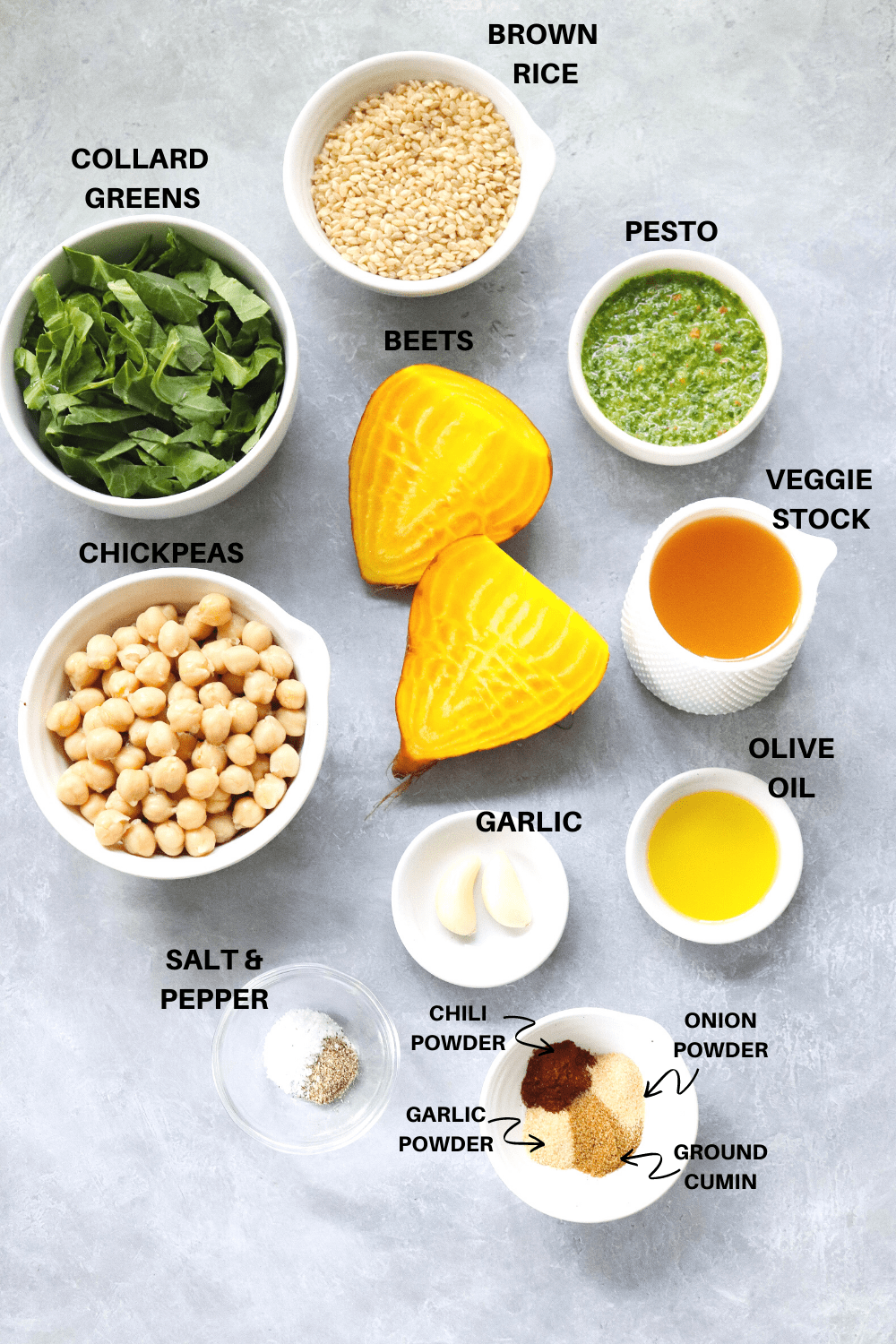 Beets, chickpeas, collards greens and other  ingredients on a gray board