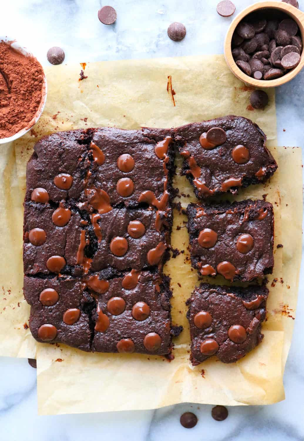 fudgy healthy brownies sliced and topped with chocolate chips