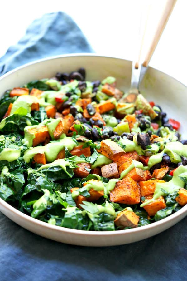 Sweet potato buddha bowl with black beans and avocado cream sauce