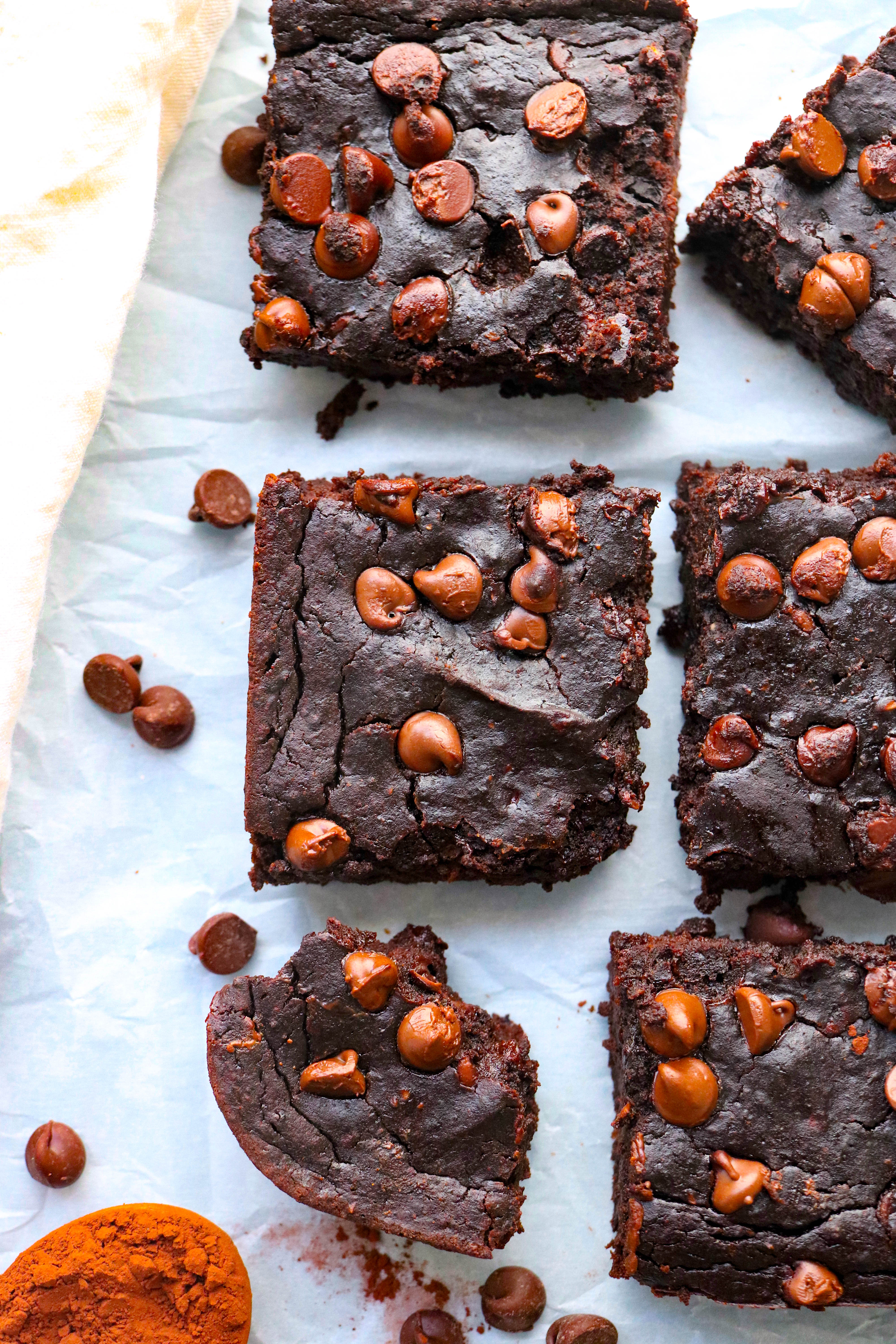 several black bean avocado brownies in a row diced into squares