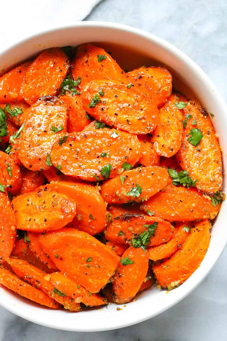Easy ranch roasted carrots in a white bowl with herbs