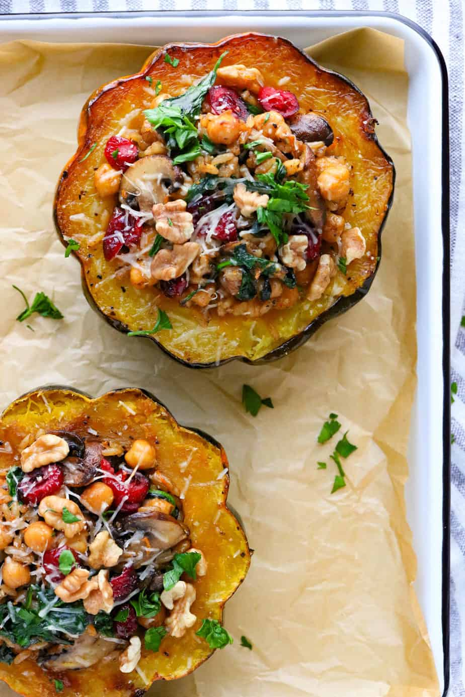 Vegetarian stuffed acorn sqaush topped with cranberries and nuts