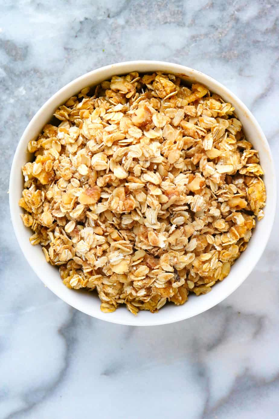 Walnut and oats crumble mix in a white bowl