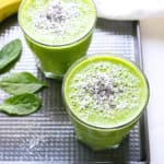 Blended Green Smoothie in two glasses on a metal tray
