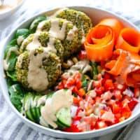 falafel veggie bowl drizzled with tahini dressing