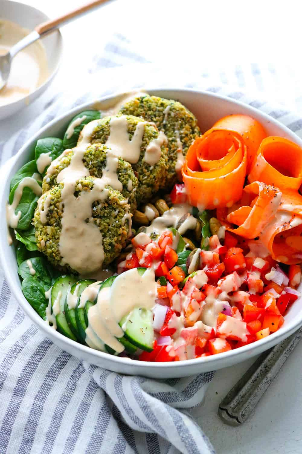 falafel veggie bowl drizzled with tahini dressing