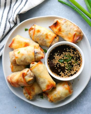 Final veggie egg rolls with tofu and a dipping sauce