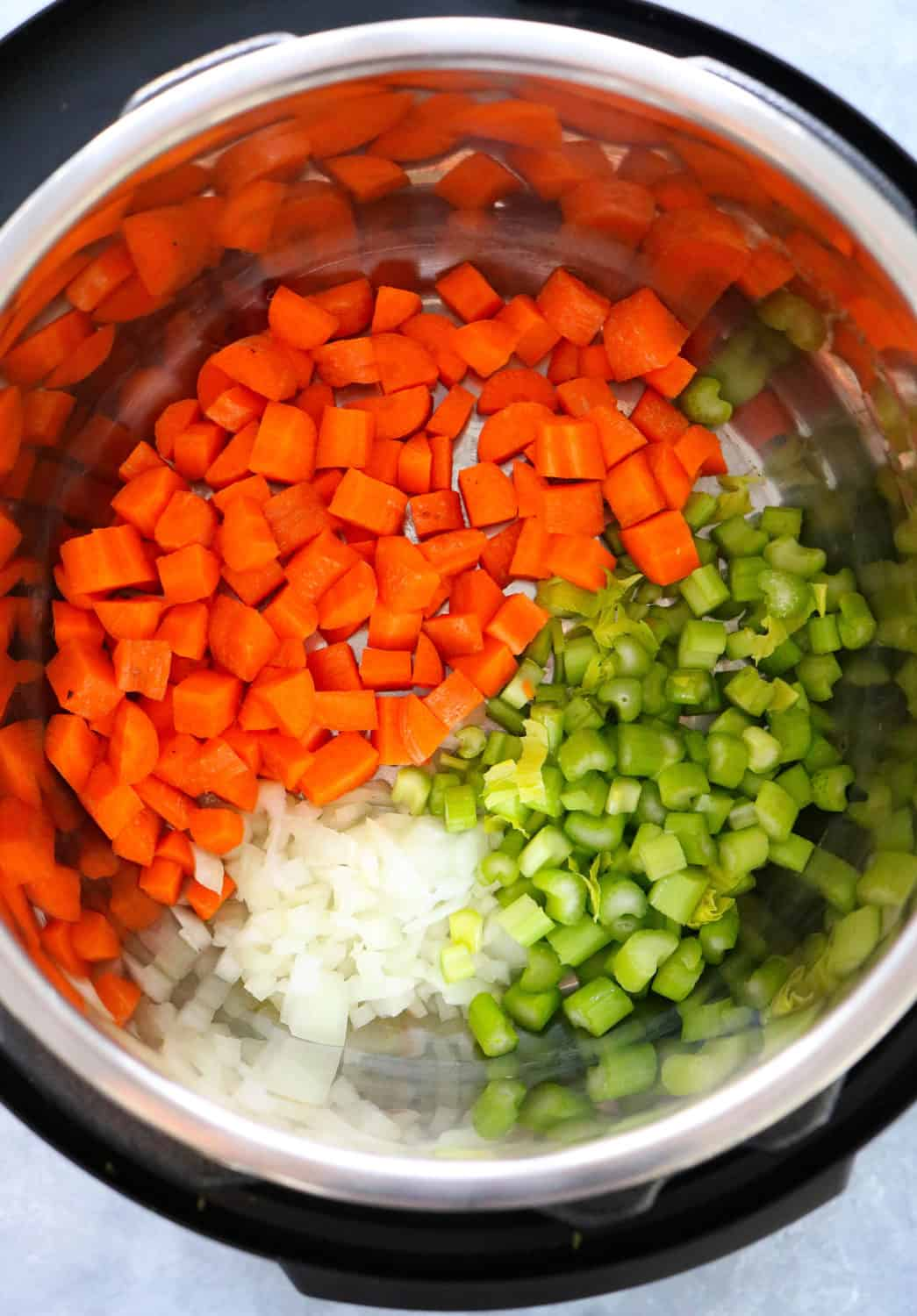 diced carrots, celery, and onion in an instant pot