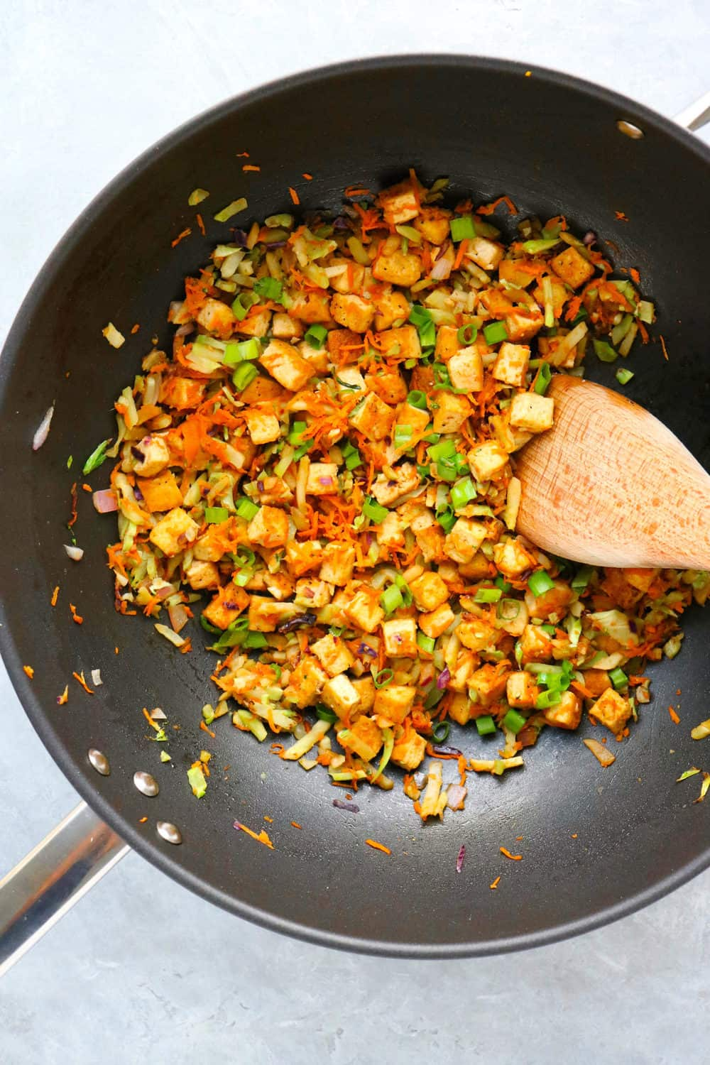 veggie egg rolling tofu filling cooking in a wok
