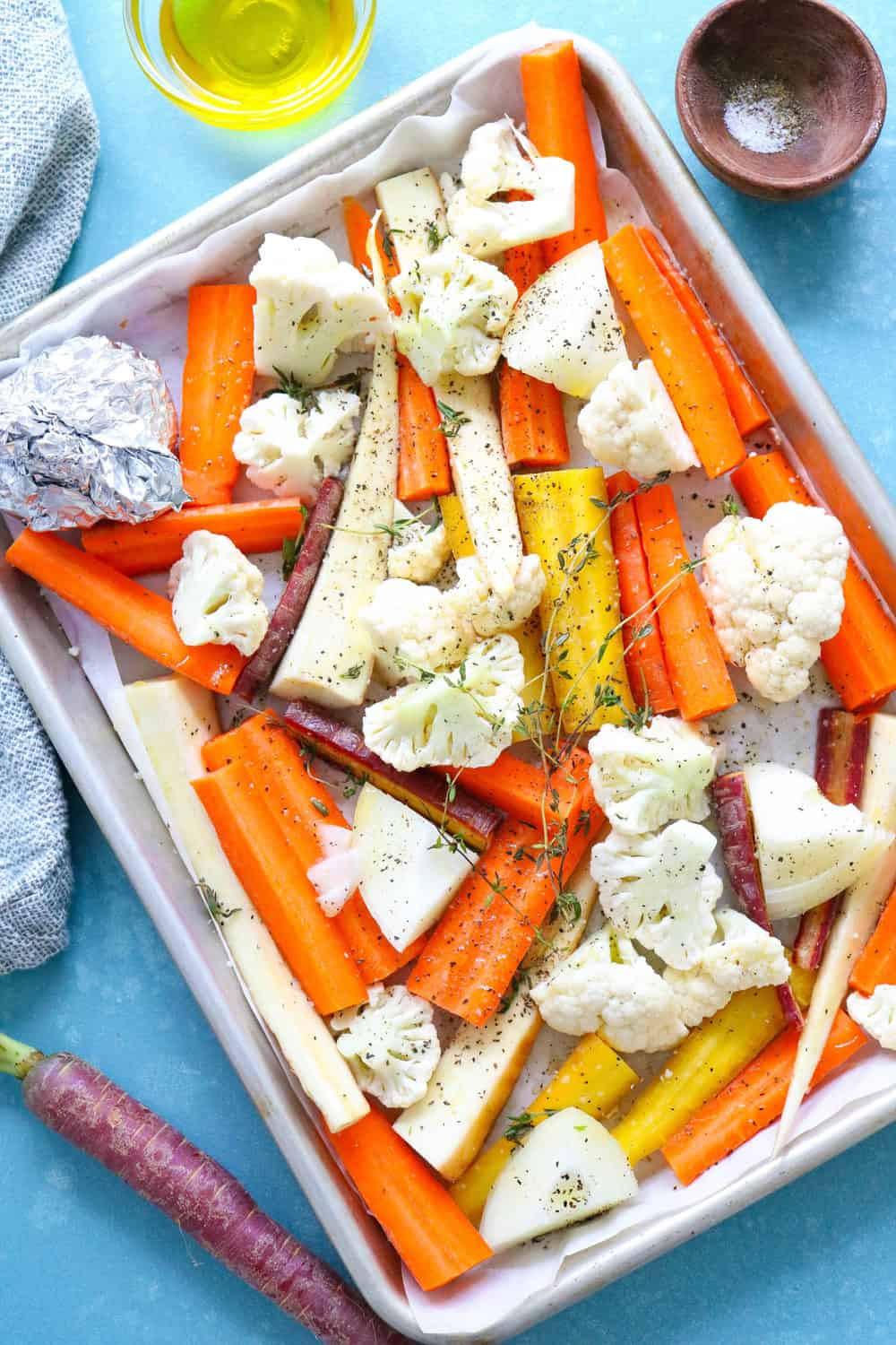 l roasted root veggies on a baking sheet with garlic and thyme