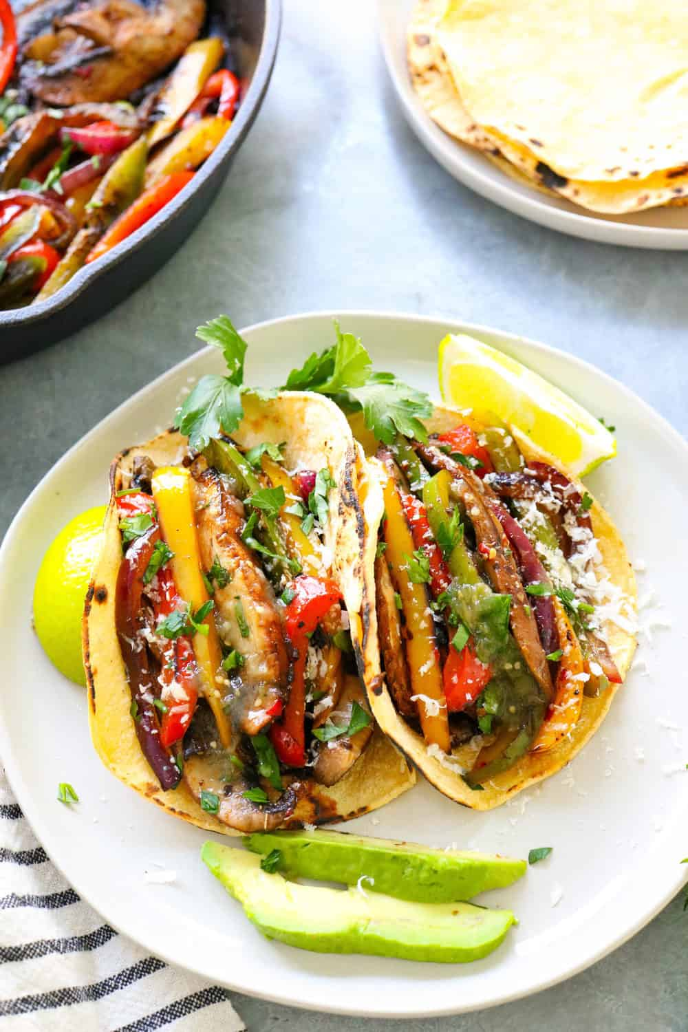 veggie fajitas on a plate with limes