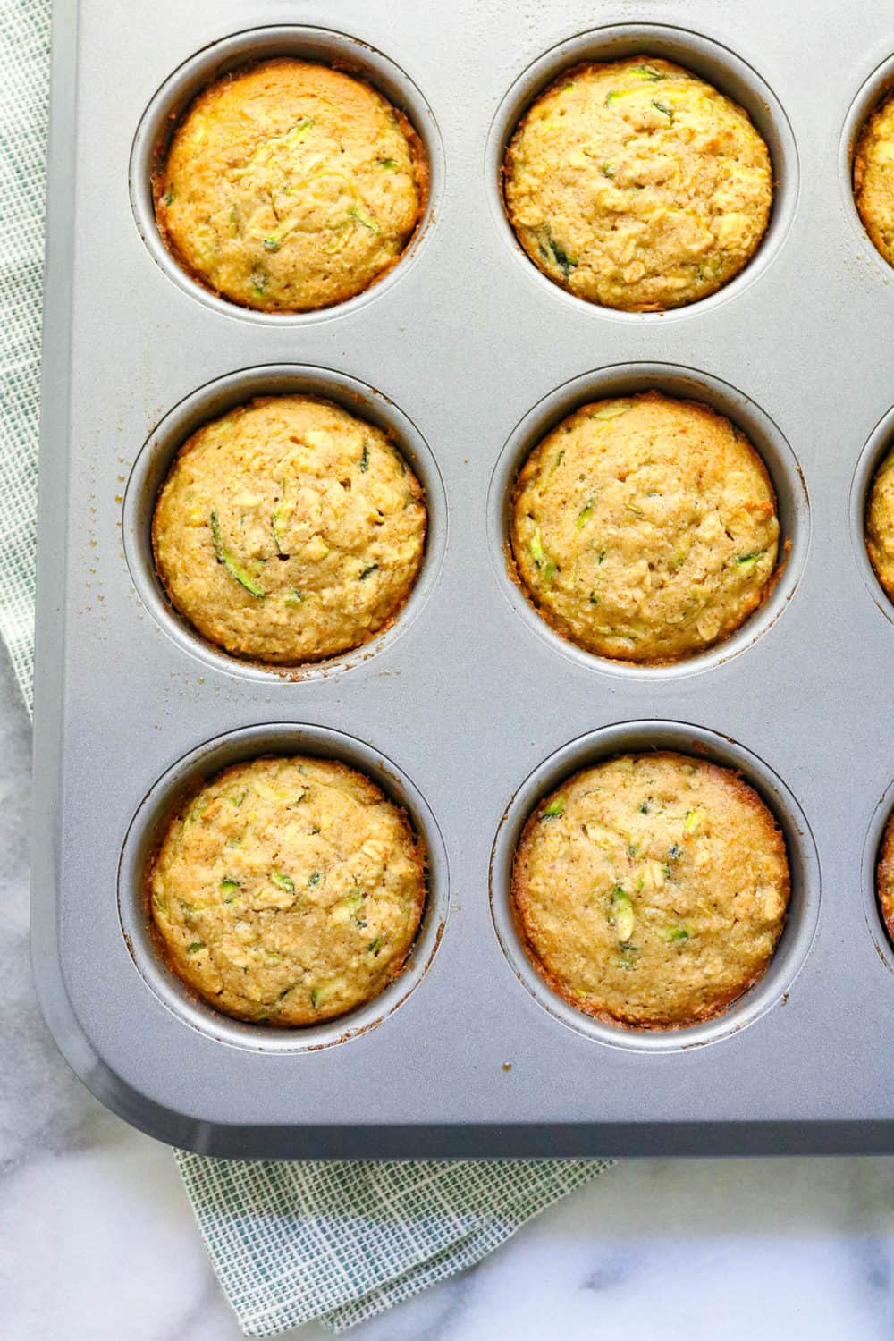 Baked zucchini muffins in a muffin pan