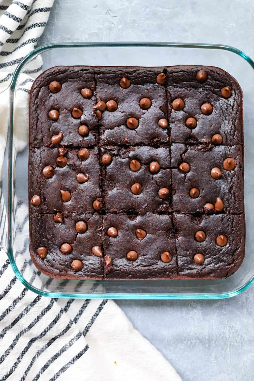 baked brownies in a pan, sliced into squares