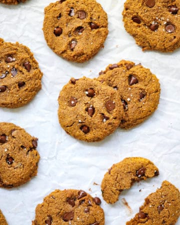 Pumpkin chocolate chip cookies on white paper