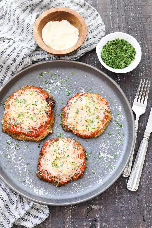 Crispy portobello mushroom parmesan on a gray plate