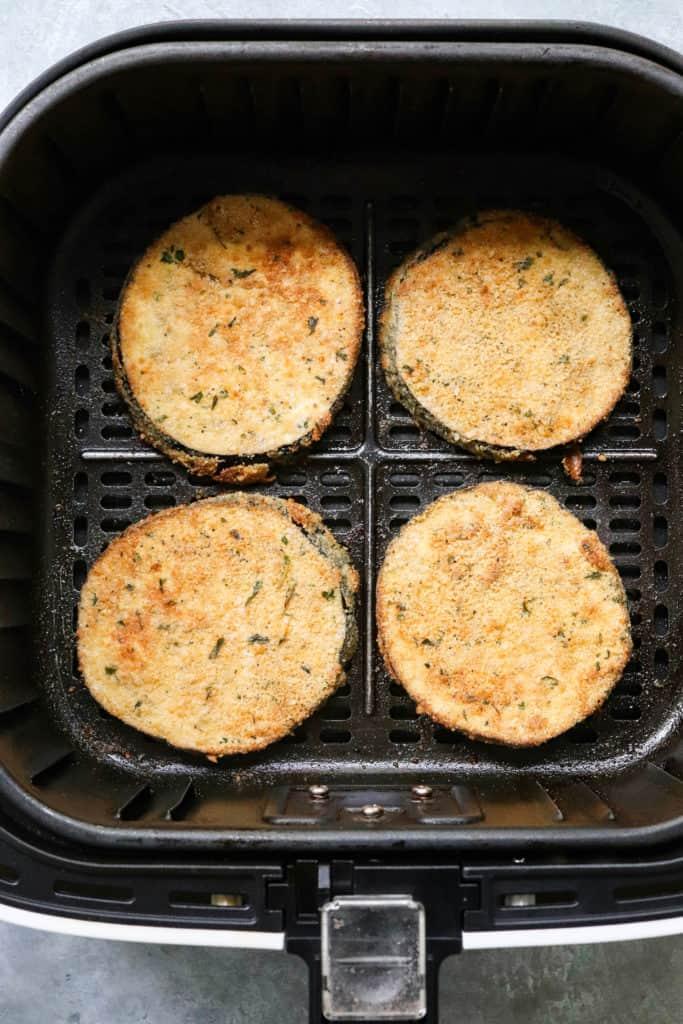 Breaded Healthy Eggplant Parmesan in an air fryer basket