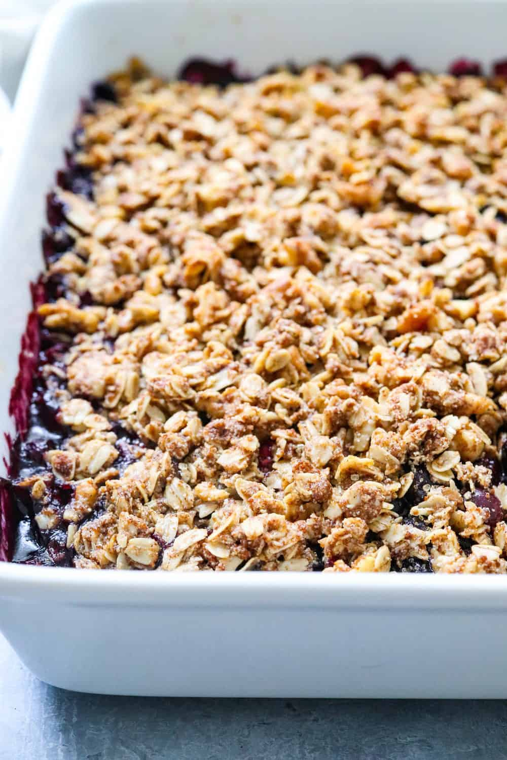 full white pan of baked crisp with oat crumble topping