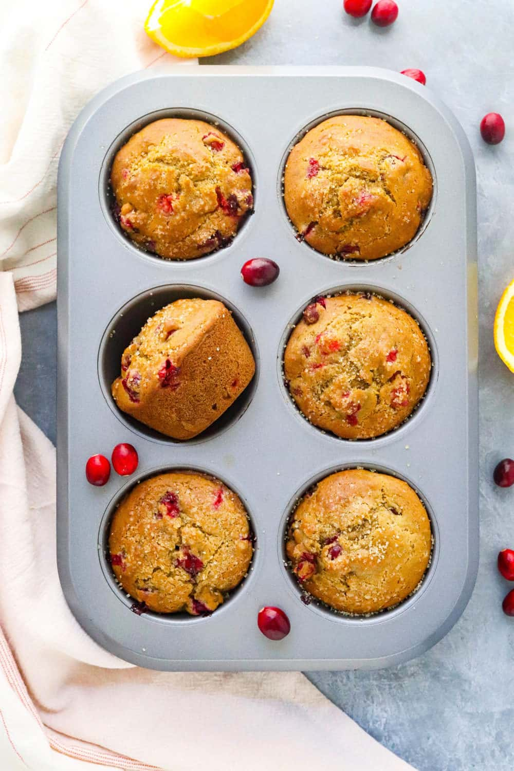 muffin pan with baked cranberry muffins in it.