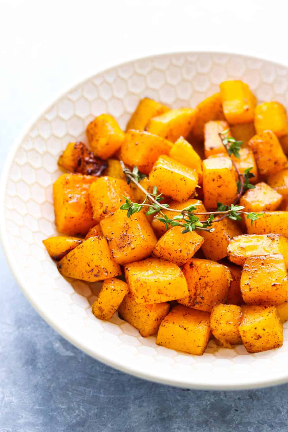 cubed squash in a round bowl with cinnamon on it