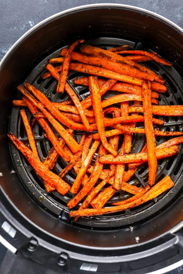 Crispy golden cooked carrot fries in an air Fryer basket