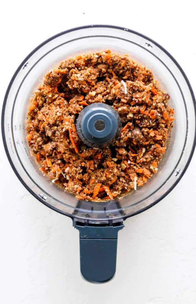 Blended carrot cake bite mixture in food processor