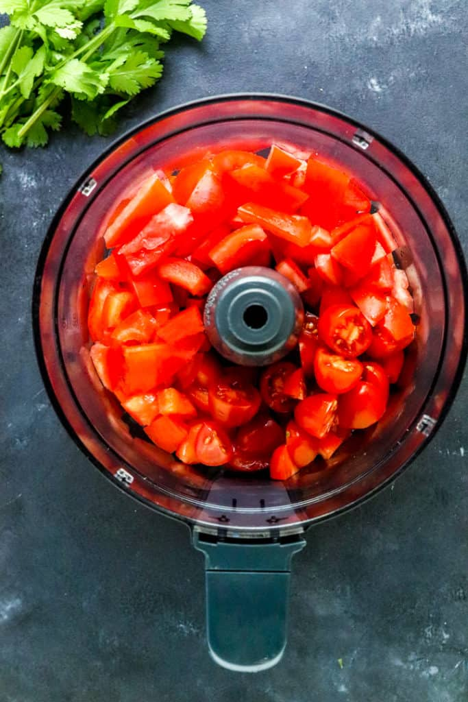 Fresh chopped tomatoes in a food processor