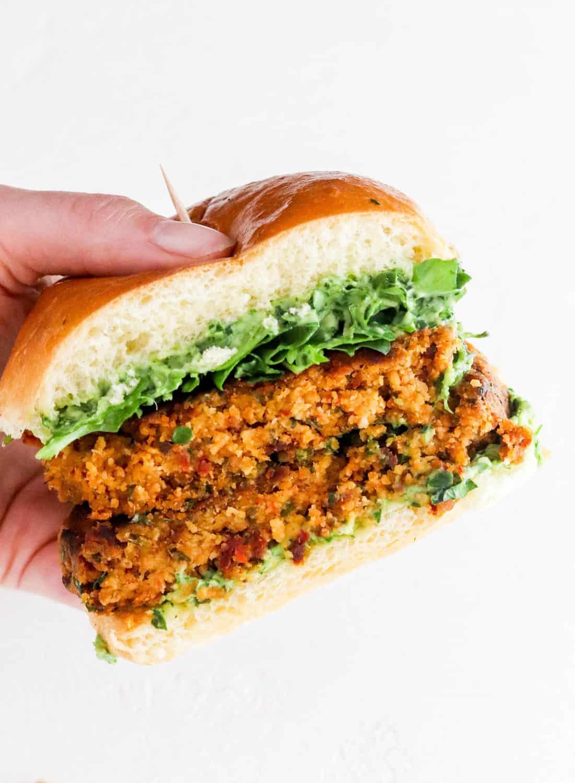 hand holding chickpea cauliflower burger easy Sumer meal