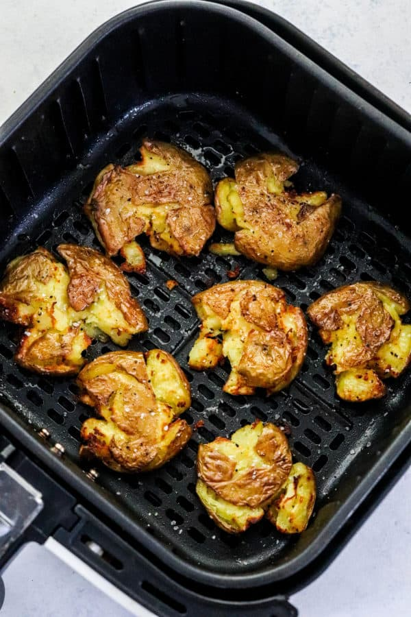 Crispy smashed round potatoes cooked in a squash air fryer basket